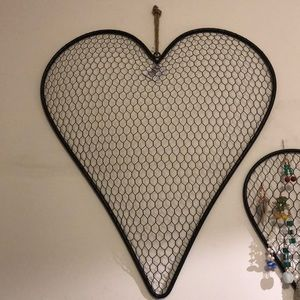 Heart shaped chicken wire coop wall art